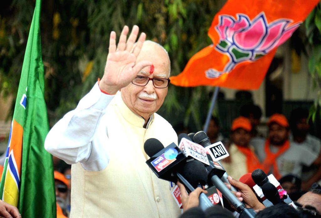 Veteran BJP leader L K Advani addresses press during a roadshow in Ahmedabad on April 16, 2014.