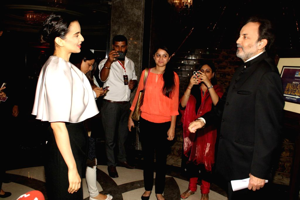 Veteran journalist and co-founder and executive co-chairperson of New Delhi Television Prannoy Roy with actress Kangana Ranaut during NDTV Indian of the Year Awards function in New Delhi on April 29, - Kangana Ranaut
