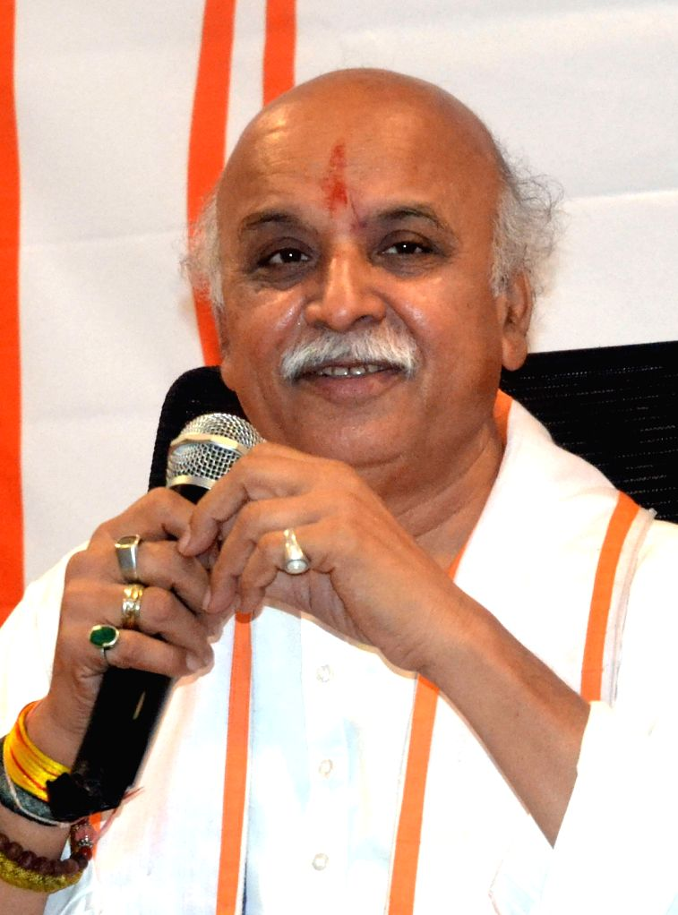 VHP leader Pravin Togadia addresses a press conference, in Bengaluru on May 21, 2018.