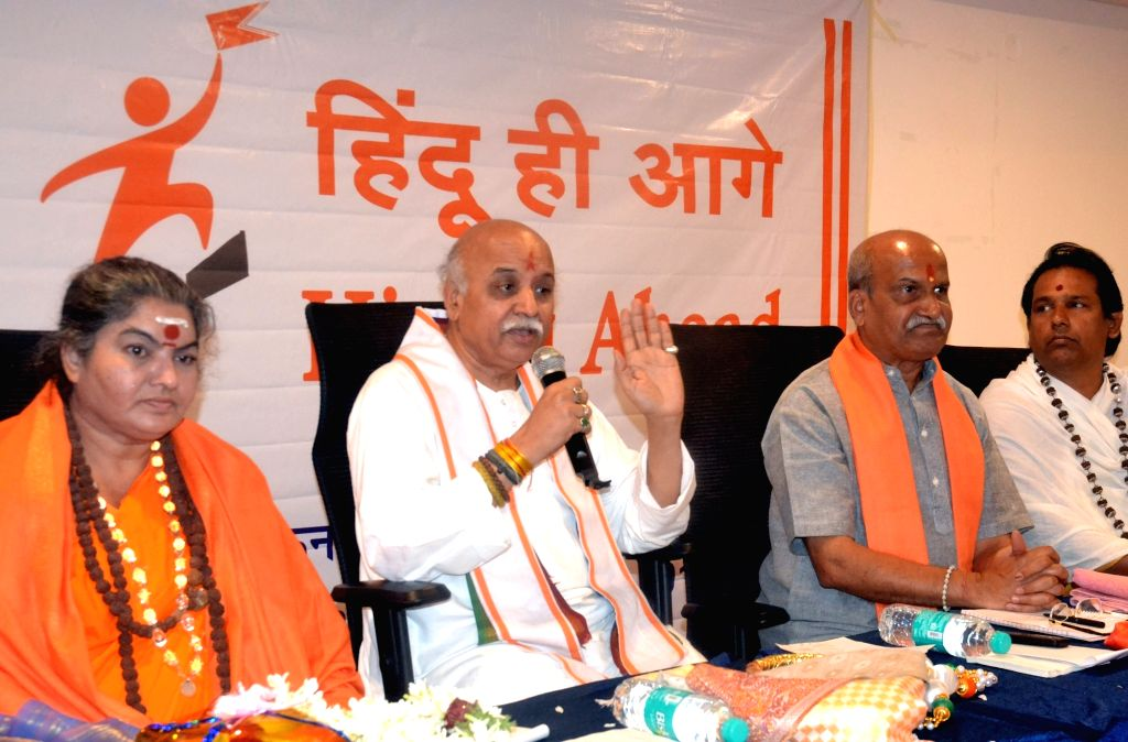 VHP leader Pravin Togadia and Sri Ram Sena Chief Pramod Muthalik during a press conference, in Bengaluru on May 21, 2018.