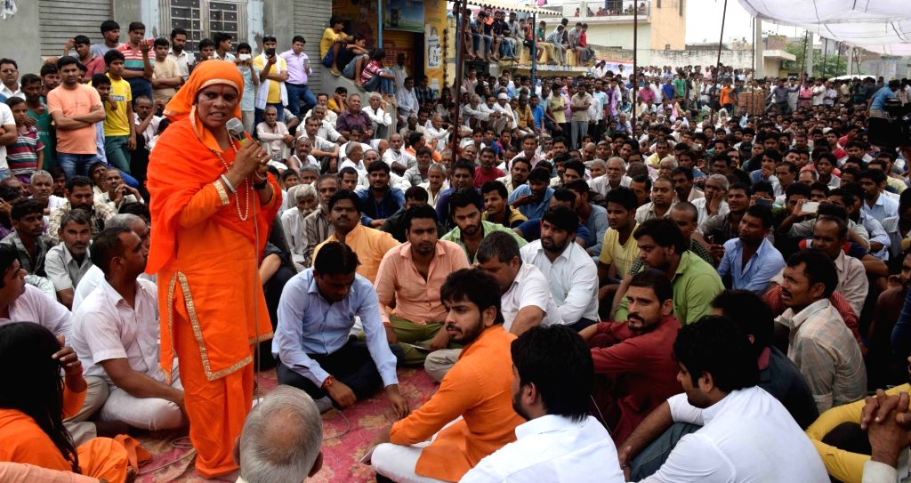 VHP leader Sadhvi Prachi addresses protesters at Bishahra village in Dadri, Uttar Pradesh on Oct 6, 2016.