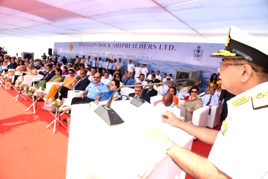 Vice Admiral A.K. Saxena addresses at the launching ceremony of Vela, the fourth of Indian Navy's stealth, Scorpene class submarine under Project 75, at the Kanhoji Angre Wet Basin of ...