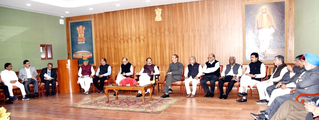 Vice President and Rajya Sabha Chairman M. Venkaiah Naidu interacts with the Floor ers of various political parties in Rajya Sabha, in New Delhi on Dec 10, 2018. - M. Venkaiah Naidu
