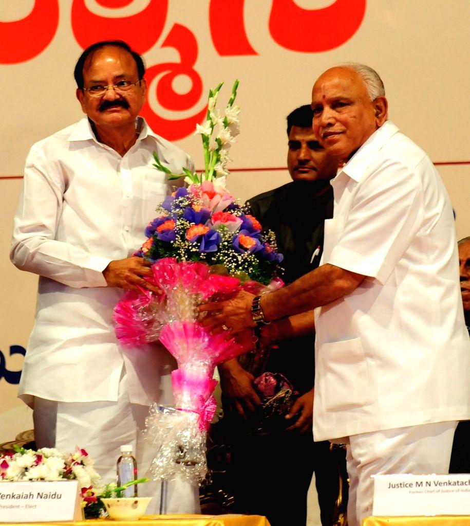 Vice President elect M Venkaiah Naidu being felicitated by Karnataka BJP chief BS Yeddyurappa during a programme in Bengaluru, on Aug 6, 2017. - M Venkaiah Naidu