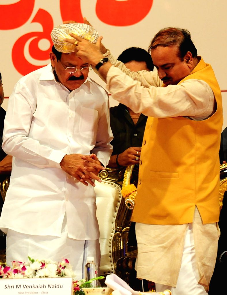 Vice President elect M Venkaiah Naidu being felicitated by Union Minister Ananth Kumar during a programme in Bengaluru, on Aug 6, 2017. - Ananth Kumar and M Venkaiah Naidu