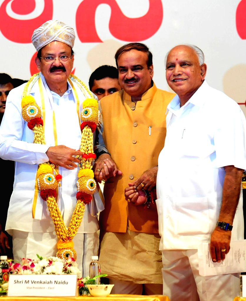 Vice President elect M Venkaiah Naidu with Karnataka BJP chief BS Yeddyurappa and Union Minister Ananth Kumar during a programme organised to felicitate him in Bengaluru, on Aug 6, 2017. - Ananth Kumar and M Venkaiah Naidu
