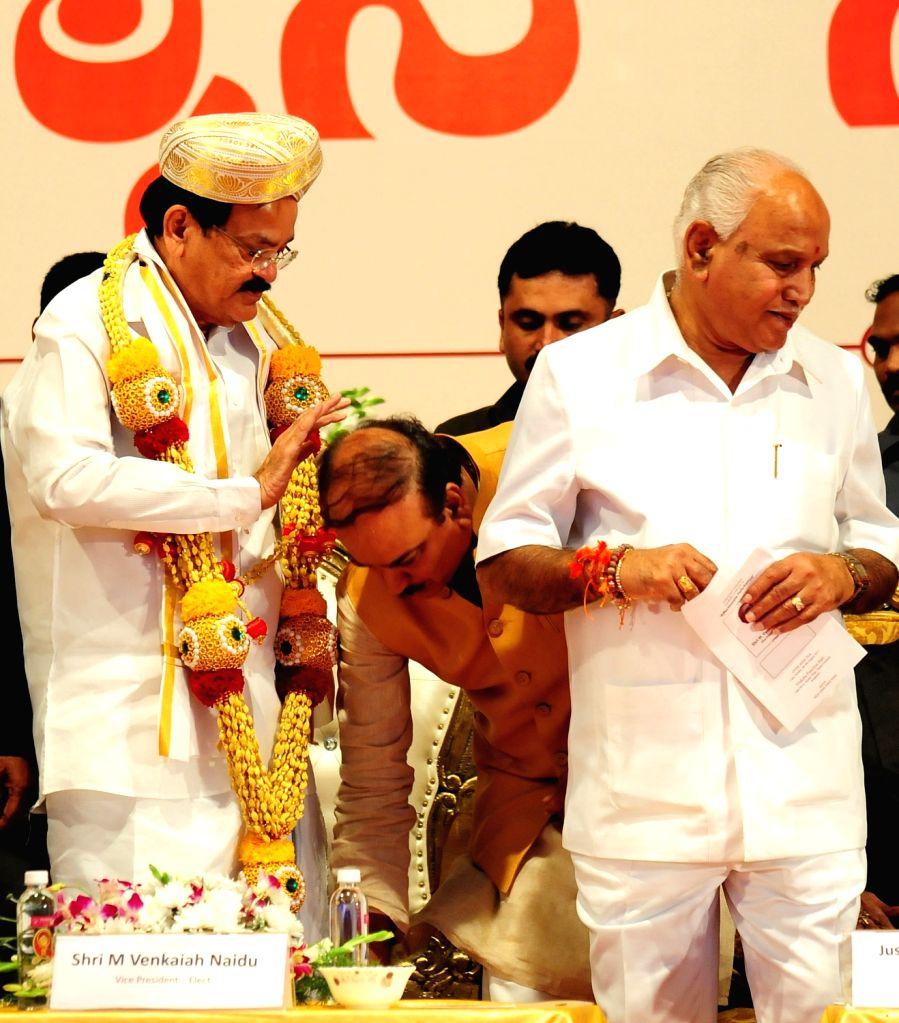 Vice President elect M Venkaiah Naidu with Karnataka BJP chief BS Yeddyurappa during a programme organised to felicitate him in Bengaluru, on Aug 6, 2017. - M Venkaiah Naidu