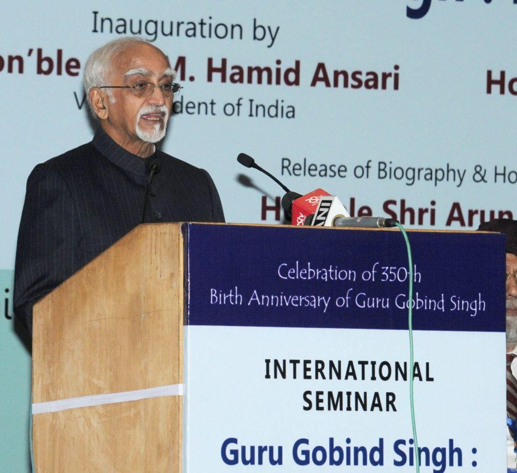 Vice President M Hamid Ansari addresses at the inauguration of the International Seminar on 'Guru Gobind Singh: Life and Legacy' in New Delhi on Nov 25, 2016. - Gobind Singh
