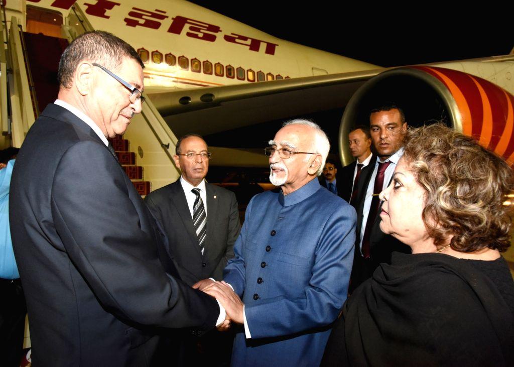 Vice President M Hamid Ansari being bid farewell by the Prime Minister of Tunisia Habib Essid, in Tunis, Tunisia on June 4, 2016.