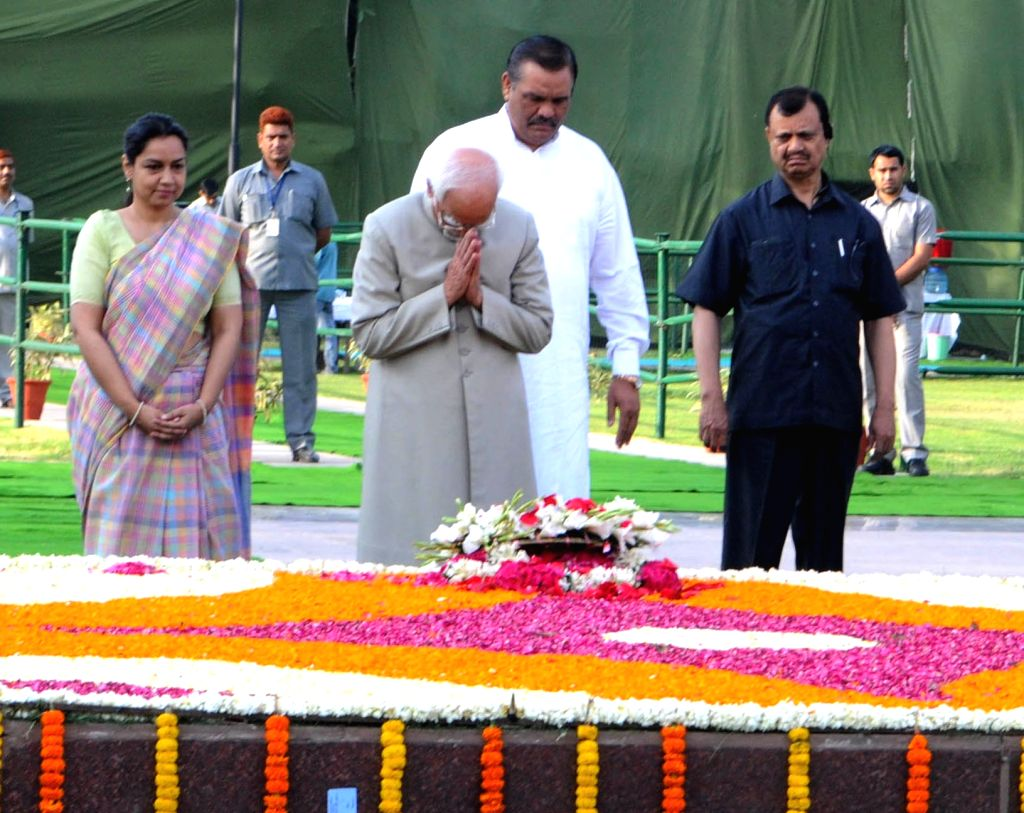 Vice President M. Hamid Ansari pays homage at the Samadhi of Babu Jagjivan Ram, on his Birth Anniversary, at Samta Sthal, in New Delhi on April 5, 2016. Also seen Union Minister of State ...