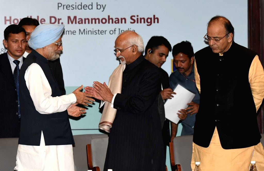 Vice President M Hamid Ansari, Union Minister for Finance and Corporate Affairs Arun Jaitley and former Prime Minister Manmohan Singh at the inauguration of the International Seminar on ... - Manmohan Singh, Affairs Arun Jaitley and Gobind Singh