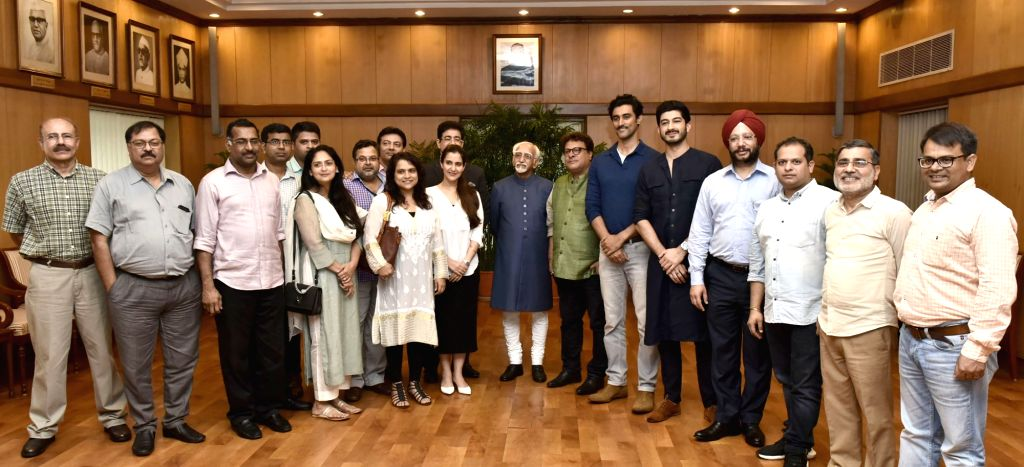 Vice President M. Hamid Ansari with the cast and crew of the film 'Raag Desh', in New Delhi on July 25, 2017.