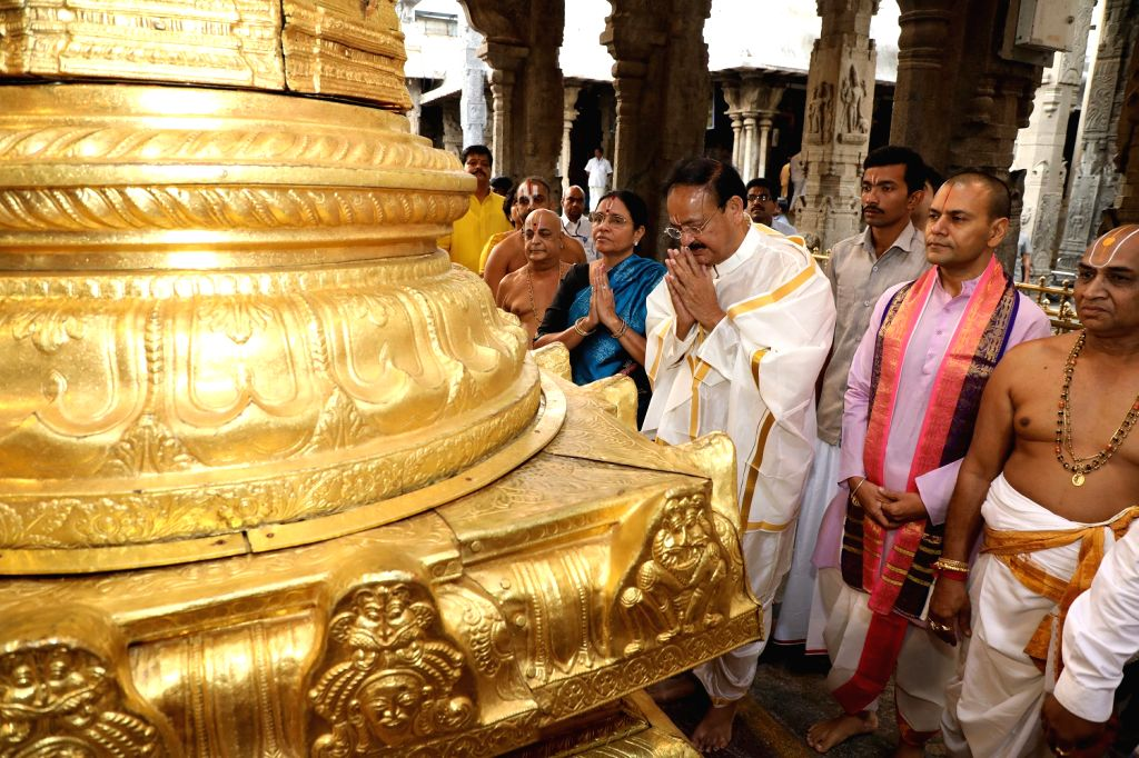 Vice President M. Venkaiah Naidu accompanied by his wife Usha, offers prayers at the Sri Venkateswara temple in Tirumala, Andhra Pradesh on June 4, 2019. - M. Venkaiah Naidu