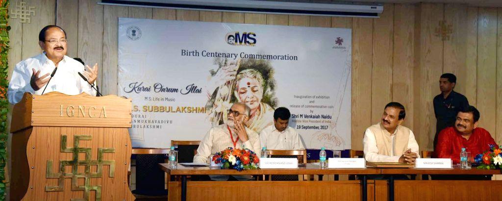 Vice President M. Venkaiah Naidu addresses a gathering at a programme to inaugurate an Exhibition during the commemoration of legendary Carnatic singer M.S. Subbulakshmi's birth centenary ... - M. Venkaiah Naidu, Change Mahesh Sharma and Secretary Sachidanand Joshi