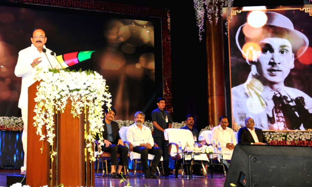 Vice President M Venkaiah Naidu addresses after presenting the Akkineni Nageswara Rao National Film Award in Hyderabad on Sept 17. 2017. Also seen Telangana Chief Minister K Chandrashekar ... - K Chandrashekar Rao and M Venkaiah Naidu