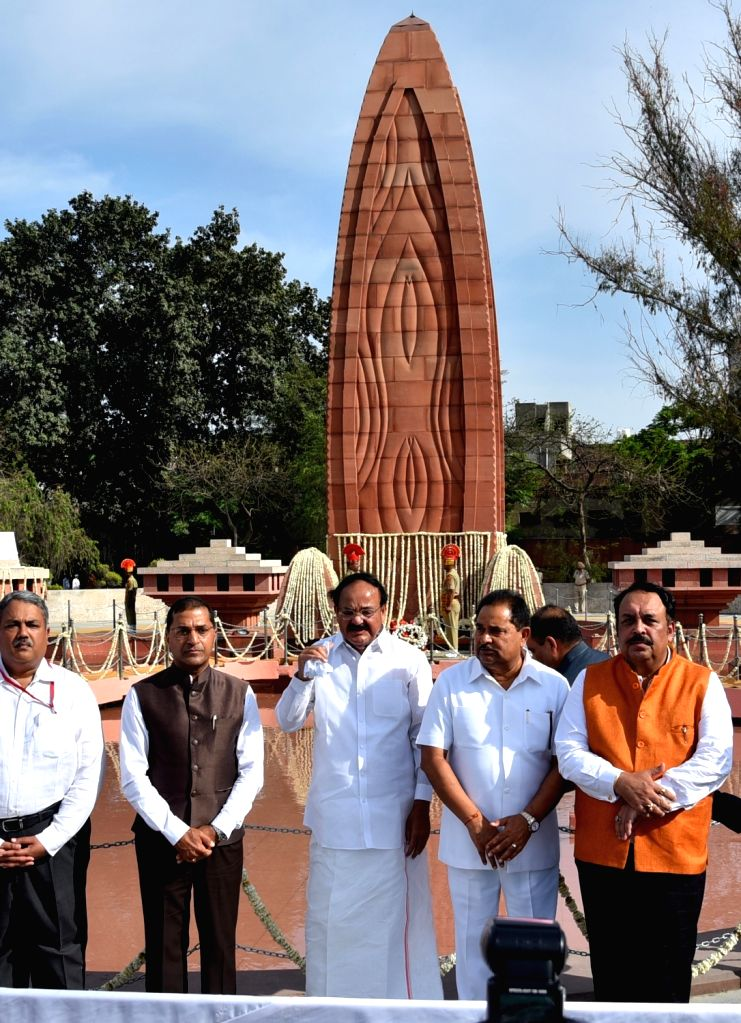 Vice President M. Venkaiah Naidu and BJP MP Shwet Malik at the launch of commemorative coin and postal stamp dedicated to Jallianwala Bagh memorial on the occasion of the 100th anniversary ... - M. Venkaiah Naidu and Malik