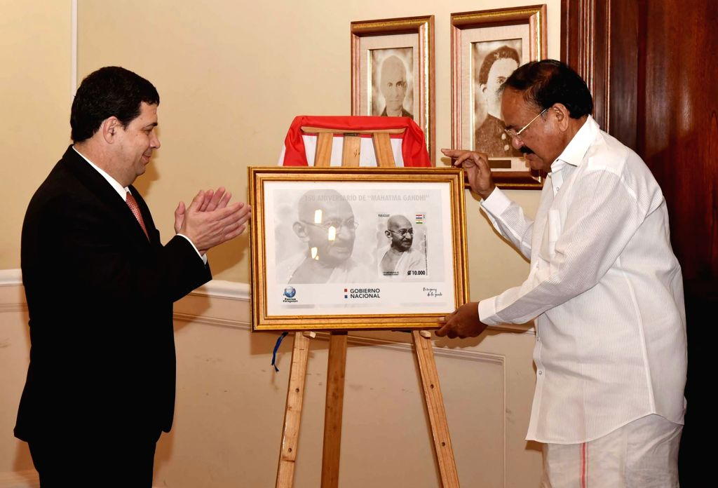 Vice President M. Venkaiah Naidu and Paraguay Vice President Hugo Velazquez jointly release a special commemorative stamp to honour Mahatma Gandhi, in Asuncion, Paraguay, on March 6, 2019. - M. Venkaiah Naidu