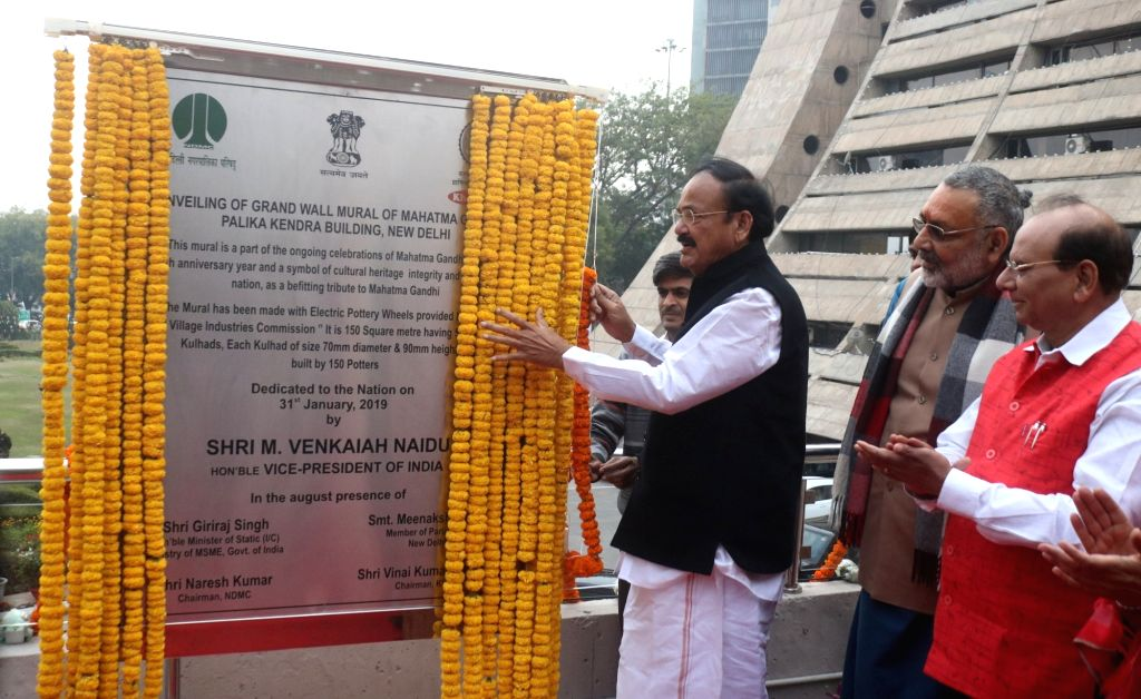 Vice President M Venkaiah Naidu and Union Minister Gajraj Singh during a programme organised to unveil Grand Wall Mural of Mahatma Gandhi at NDMC Headquarter Building in New Delhi on Jan ... - Gajraj Singh and M Venkaiah Naidu