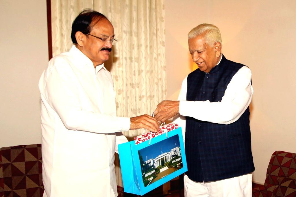 Vice-President M. Venkaiah Naidu calls on Karnataka Governor Vajubhai Vala during his visit to Raj Bhavan in Bengaluru on Sept 27, 2017. - M. Venkaiah Naidu
