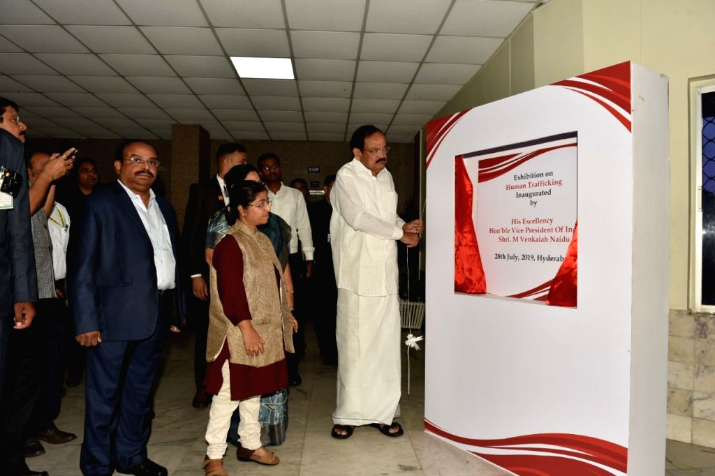 Vice President M. Venkaiah Naidu inaugurates the exhibition on Human Trafficking organised on the occasion of World Day Against Trafficking in Persons, in Hyderabad on July 28, 2019. Also ... - M. Venkaiah Naidu