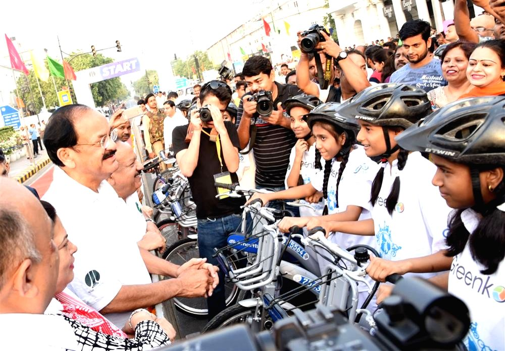 Vice President M. Venkaiah Naidu interacts with the students participating in a Bicycle Rally, on World Bicycle Day 2018, in New Delhi on June 3, 2018. Also seen Union Environment Minister ... - Harsh Vardhan and M. Venkaiah Naidu