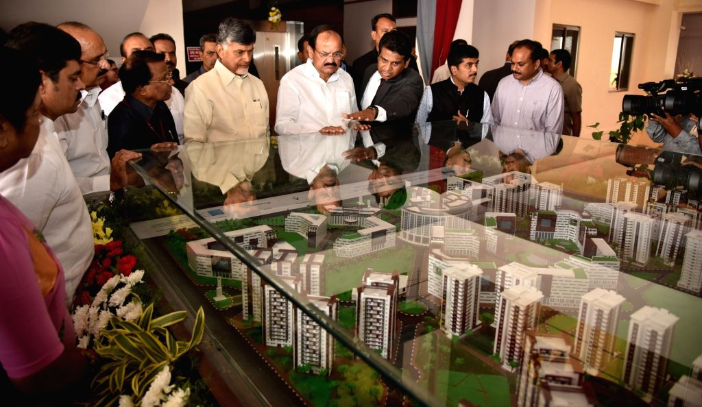 Vice President M Venkaiah Naidu looks at the model of new campus of Vellore Institute of Technology, in Amaravati, Andhra Pradesh on Nov 28, 2017. Also seen Andhra Pradesh Chief Minister N ... - N Chandrababu Naidu and M Venkaiah Naidu