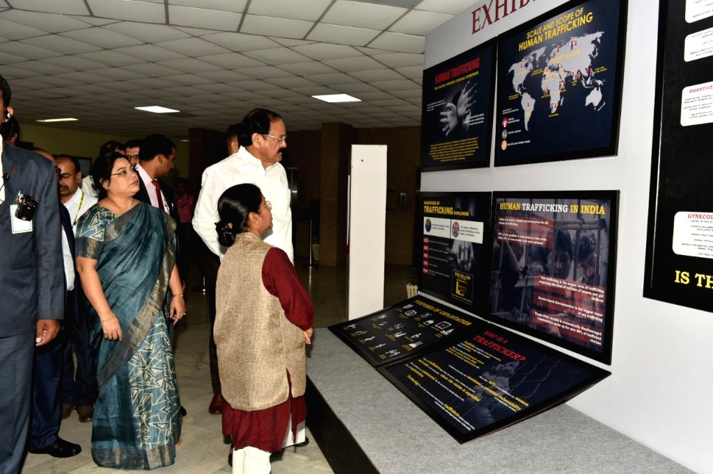 Vice President M. Venkaiah Naidu looks at the exhibition on Human Trafficking organised on the occasion of World Day Against Trafficking in Persons, in Hyderabad on July 28, 2019. Also ... - M. Venkaiah Naidu