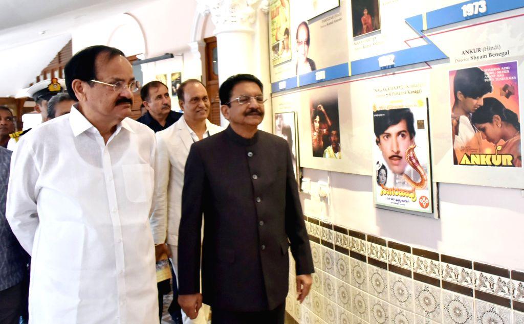 Vice President M. Venkaiah Naidu looks at various exhibits during his visit to the National Museum of Indian Cinema, in Mumbai on April 26, 2019. Also seen Maharashtra Governor C. Vidyasagar ... - M. Venkaiah Naidu and C. Vidyasagar Rao