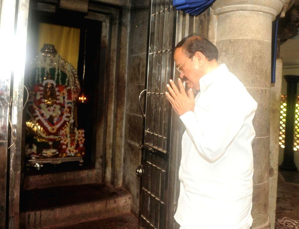 Vice President M. Venkaiah Naidu offers prayers during his visit to the Adi Shankaracharya Temple in Kochi, Kerala on May 21, 2018. - M. Venkaiah Naidu