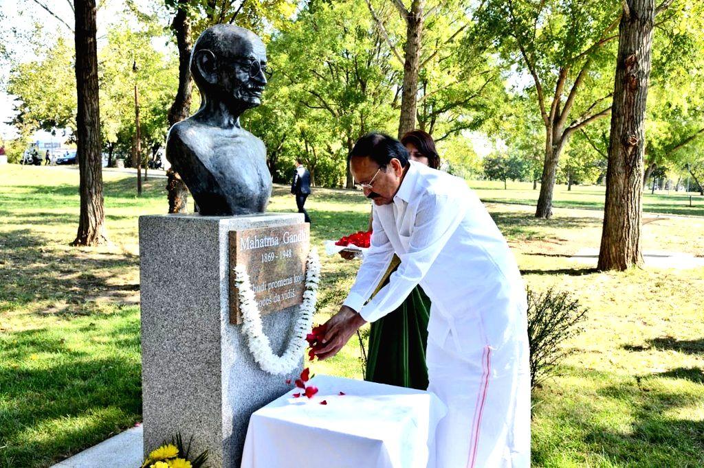 Vice President M. Venkaiah Naidu pays tributes to Mahatma Gandhi's bust in Belgrade, Serbia on Sept 16, 2018. - M. Venkaiah Naidu
