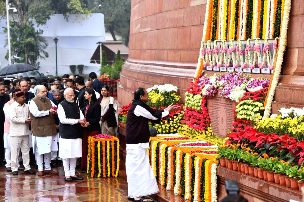 Vice President M. Venkaiah Naidu pays tributes to the martyrs on 18th anniversary of Parliament attack at Parliament House in New Delhi on Dec 13, 2019. Also seen Prime Minister Narendra ... - Narendra Modi, M. Venkaiah Naidu and Amit Shah