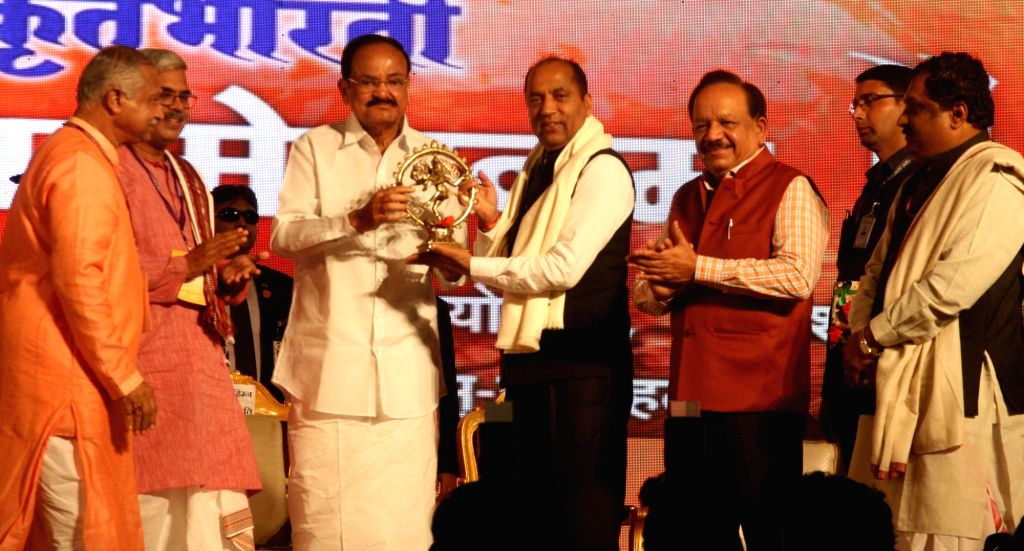 Vice President M. Venkaiah Naidu presents a memento to Himachal Pradesh Chief Minister Jai Ram Thakur the World conference organized by Sanskrit Bharti for according second language status ... - Jai Ram Thakur and M. Venkaiah Naidu