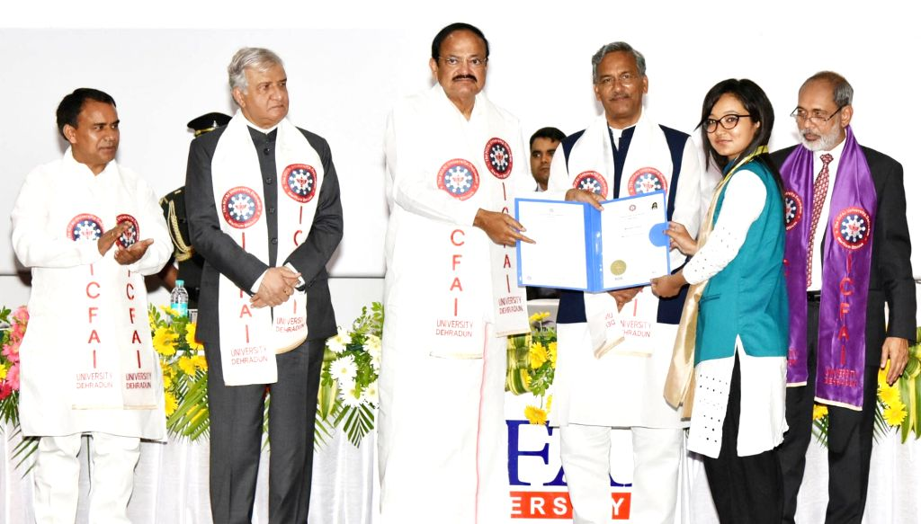 Vice President M. Venkaiah Naidu presents degree to a student along with Uttarakhand Chief Minister Trivendra Singh Rawat at the Convocation of ICFAI University, in Dehradun on July 14, ... - Trivendra Singh Rawat and M. Venkaiah Naidu