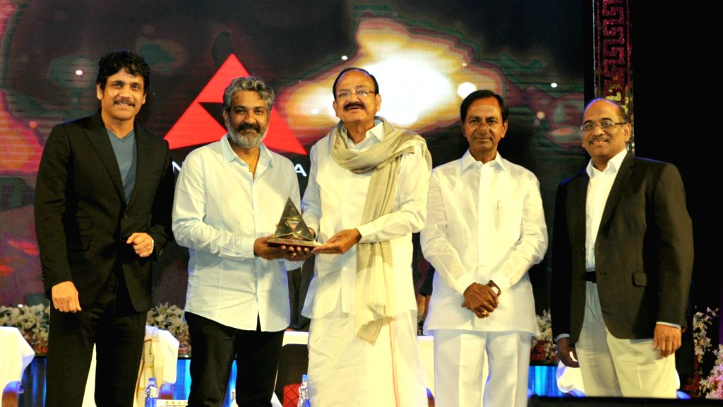 Vice President M Venkaiah Naidu presents the Akkineni Nageswara Rao National Film Award to director SS Rajamouli during the Akkineni Nageswara Rao National Film Award in Hyderabad on Sept ... - K Chandrashekar Rao and M Venkaiah Naidu