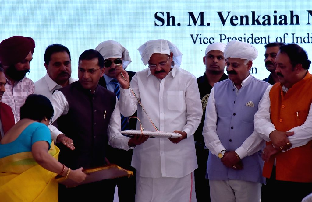 Vice President M. Venkaiah Naidu, Punjab Governor V.P. Singh Badnore and BJP MP Shwet Malik at the launch of commemorative coin and postal stamp dedicated to Jallianwala Bagh memorial on ... - M. Venkaiah Naidu, Malik and P. Singh Badnore