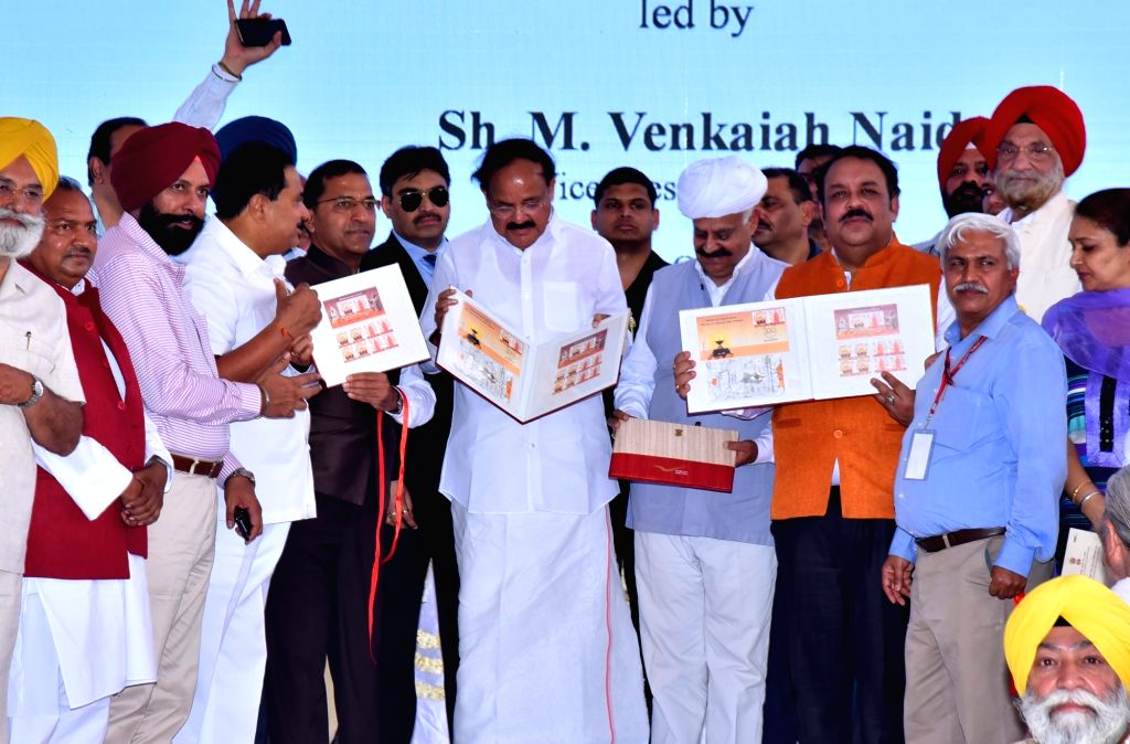 Vice President M. Venkaiah Naidu, Punjab Governor V.P. Singh Badnore and BJP MP Shwet Malik unveil the commemorative postal stamp dedicated to Jallianwala Bagh memorial on the occasion of ... - M. Venkaiah Naidu, Malik and P. Singh Badnore