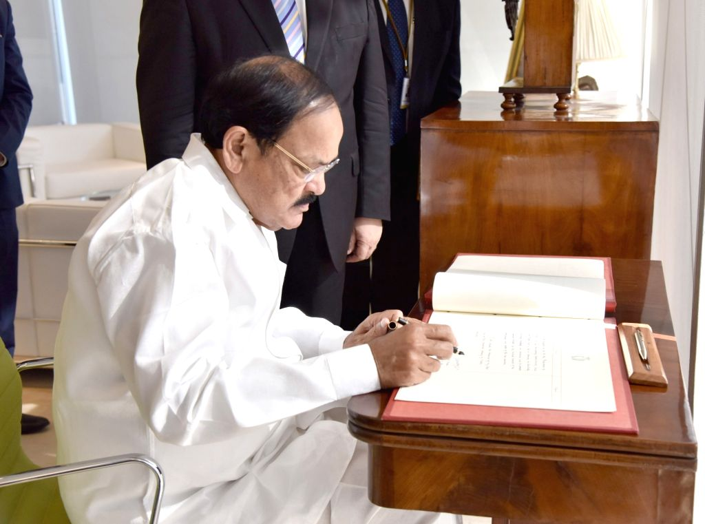 Vice President M. Venkaiah Naidu signs the visitor's book, at the Parliament of Malta, in Valletta, Malta, on Sept 18, 2018. - M. Venkaiah Naidu
