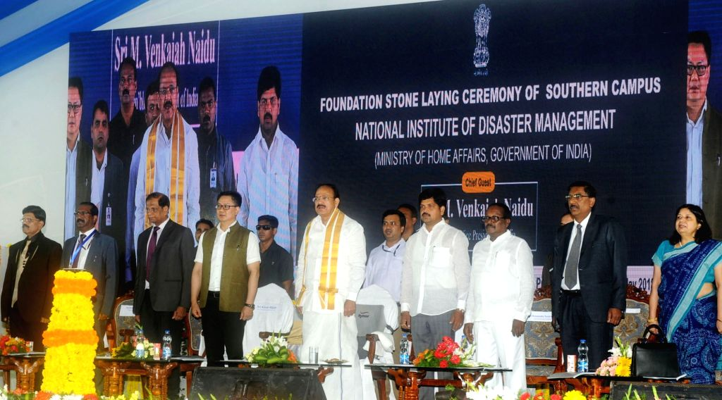 Vice President M. Venkaiah Naidu, Union MoS Home Affairs Kiren Rijiju, Andhra Pradesh's Law and Justice Minister Kollu Ravindra and other dignitaries during a programme to lay the ... - Kollu Ravindra and M. Venkaiah Naidu