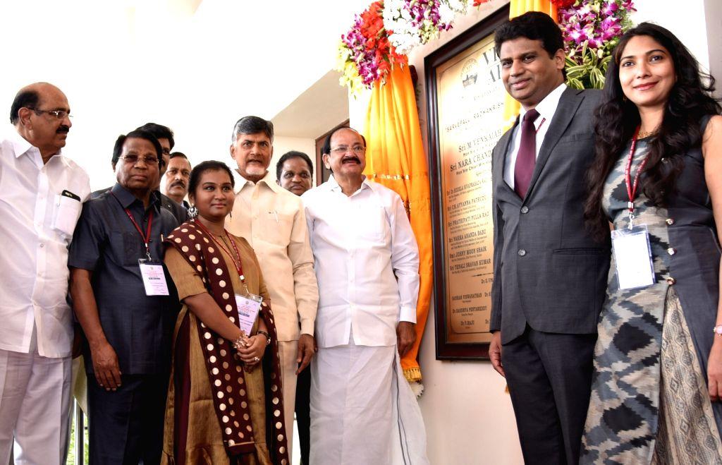 Vice President M Venkaiah Naidu unveils the plaque to inaugurate the new campus of Vellore Institute of Technology, in Amaravati, Andhra Pradesh on Nov 28, 2017. Also seen Andhra Pradesh ... - N Chandrababu Naidu and M Venkaiah Naidu