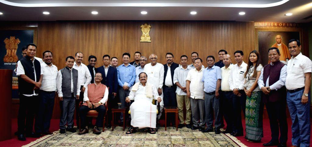 Vice President M. Venkaiah Naidu with the newly elected members of Meghalaya legislators, in New Delhi on Augt 3, 2018. - M. Venkaiah Naidu