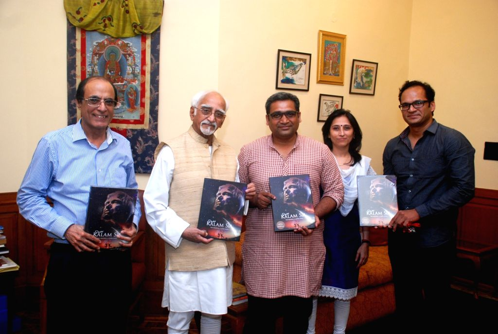 Vice President Mohammad Hamid Ansari accepts a copy of Dear Kalam Sir from Jubie John (centre) Bloomsbury India MD Rajiv Beri (extreme left). Also seen editors Paul (extreme right) and ...