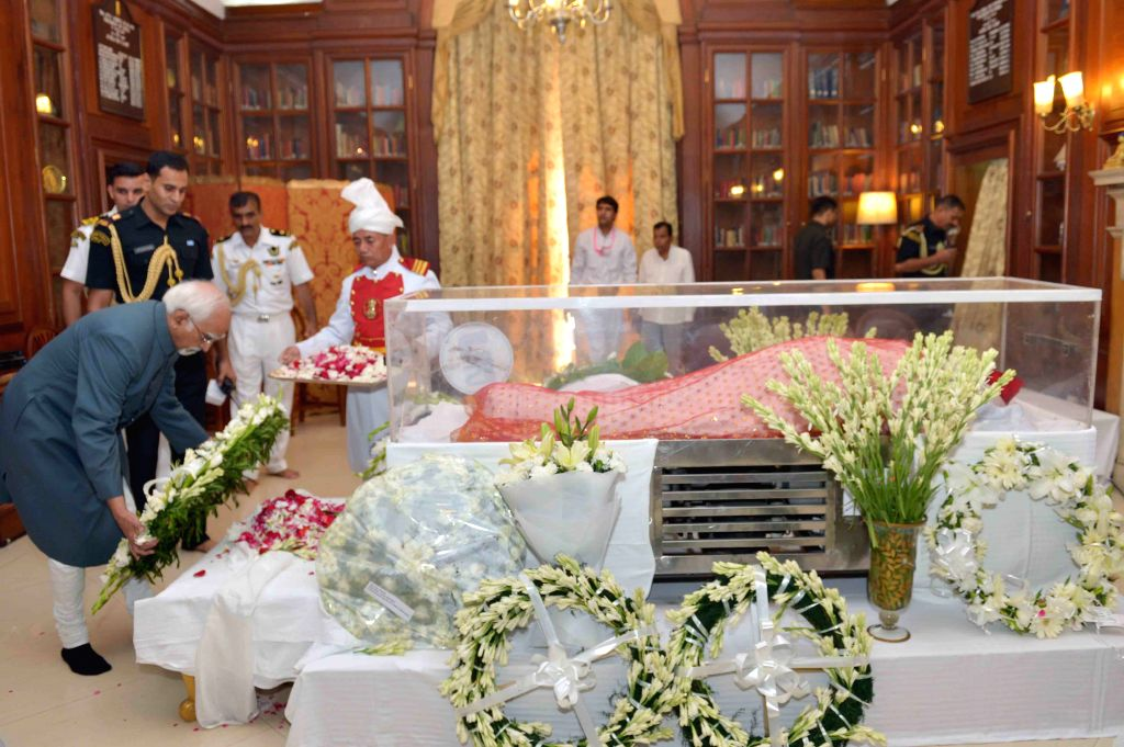 Vice-President Mohammad Hamid Ansari pays tribute to the mortal remains of President Pranab Mukherjee's wife Suvra at Rashtrapati Bhawan on Aug 18, 2015. - Pranab Mukherjee