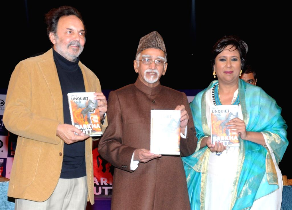 """Vice President Mohd Hamid Ansari releases the book titled """"This Unquiet Land: Stories from India's Fault Lines"""", written by Barkha Dutt, in New Delhi on Dec 9, 2015. Also seen veteran journalist ... - Barkha Dutt and Prannoy Roy"""