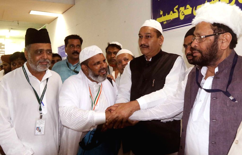 Vice President of Haj Committee of India Sultan Ahmed and West Bengal Minister Firhad Hakim see off the first batch of haj pilgrims from Kolkata on Aug 10, 2016. - Firhad Hakim