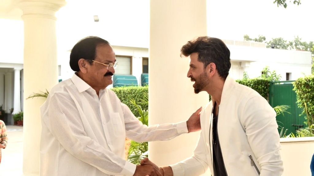 "Vice President Venkaiah Naidu says he was happy to watch ""Super 30"" at the Uprashtrapati Bhawan in the national capital along with Bollywood actor Hrithik Roshan and educationist Anand ... - Hrithik Roshan, Venkaiah Naidu and Anand Kumar"