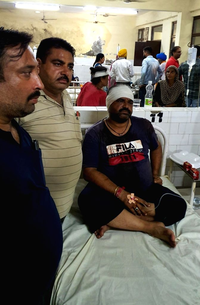 Victims of a blast at an unauthorized firecracker factory in a residential in Batala town of Punjab's Gurdaspur district receive treatment; at Guru Nanak Hospital in Amritsar on Sep 4, ...