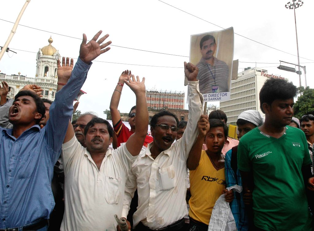 Victims of multi-crore-rupee chit fund scams protest against West Bengal Government in Kolkata on Sept 11, 2014.