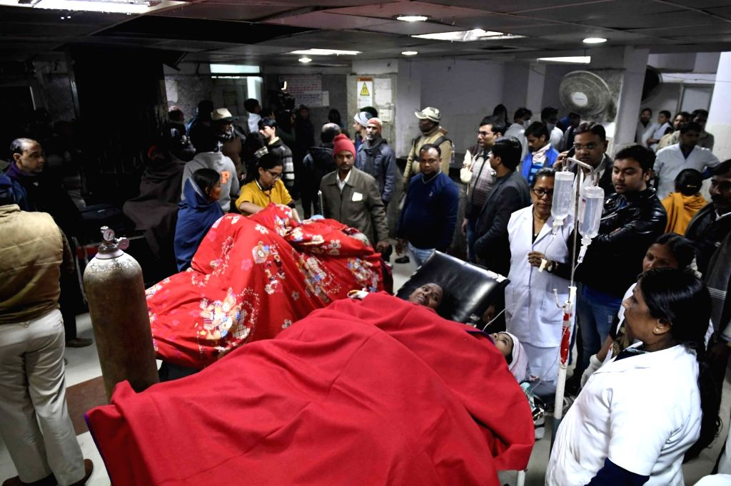 Victims of Patna boat accident being taken for treatment at a hospital on Jan 14, 2017.At least 17 passengers were killed and many others were missing as a boat carrying 40 people capsized in ...