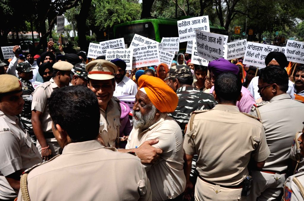 Victims of the 1984 Anti-Sikh riots and their family members stage a demonstration against the Congress over Indian Oversees Congress chief Sam Pitroda's remarks on 1984 anti-Sikh riots, ...