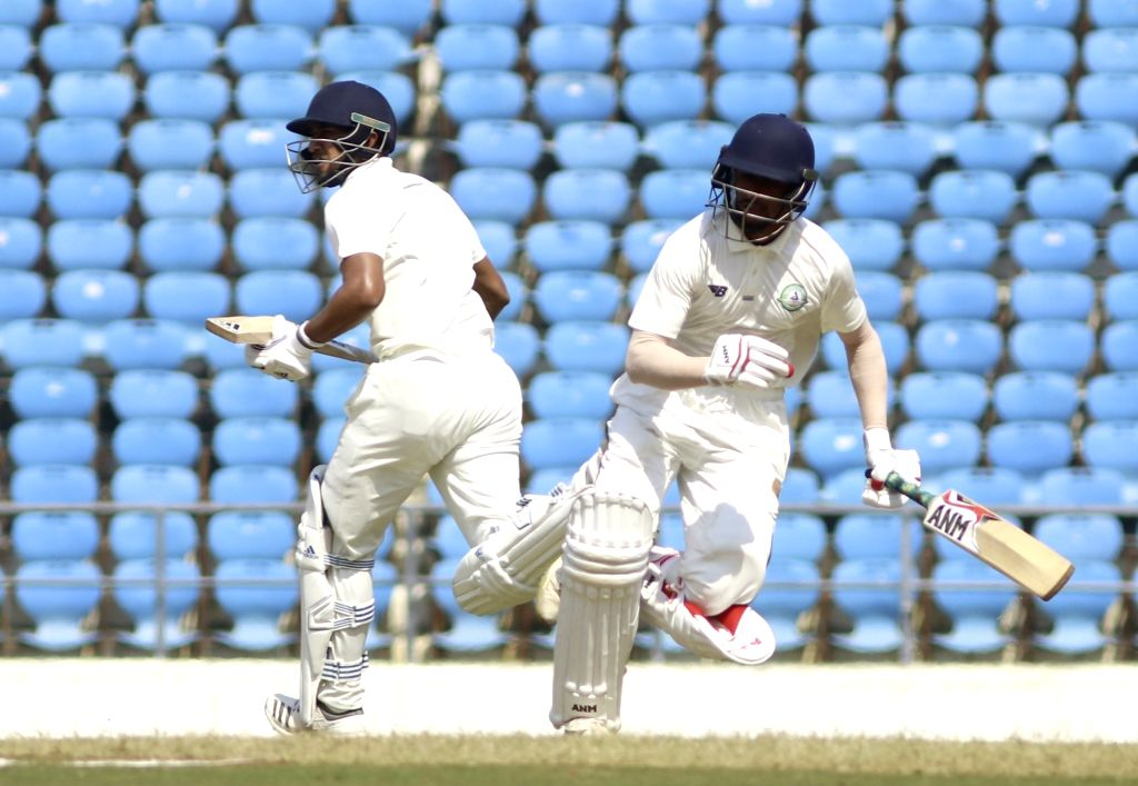 Vidarbha batsmen Ganesh Satish and Sanjay Raghunath in action on the Second Day of Irani Cup match between Rest of India and Vidarbha at Vidarbha Cricket Association Stadium, in Jamtha, ...